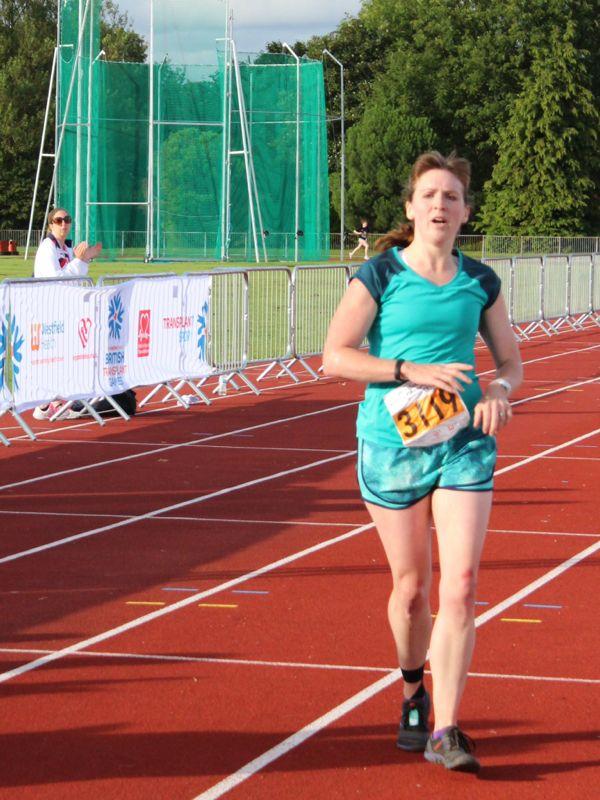 Melissa crossing the Mini Marathon finish line
