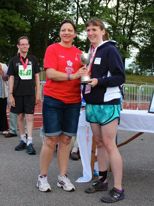 Melissa collecting her Mini Marathon trophy
