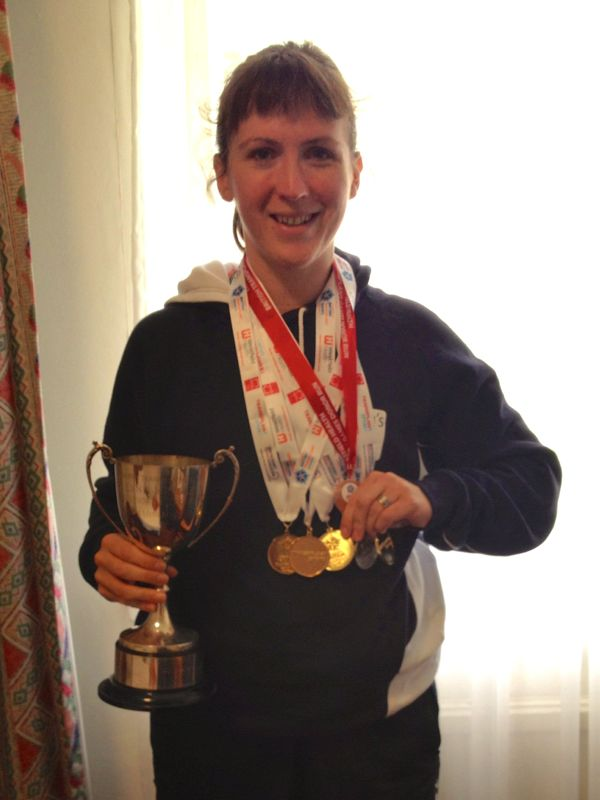 Melissa with final medals and trophy
